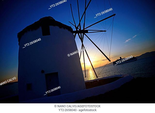 Traditional windmills (Kato Milli) at sunset in Mykonos town, Greece