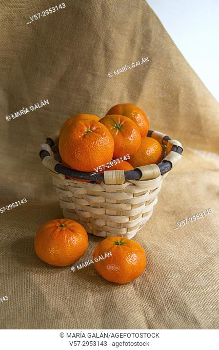 Basket full of mandarines. Still life