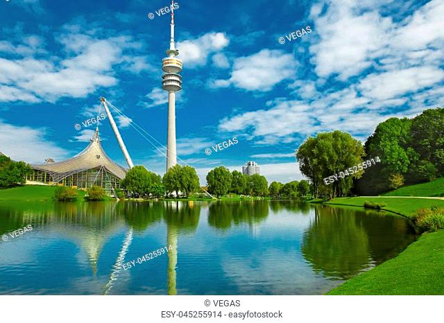 View on Olympiapark with Olympic tower at Munich, Bavaria, Germany. Green park at city