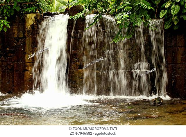 Beautiful waterfall in wild forest, long exposure