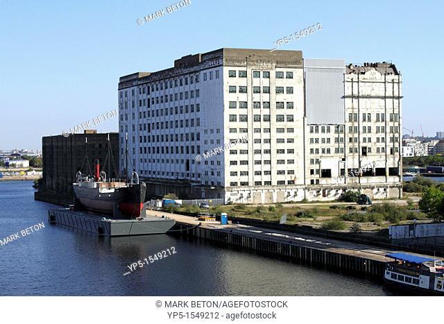 Derelict buildings at Royal Victoria Dock, London, England, UK