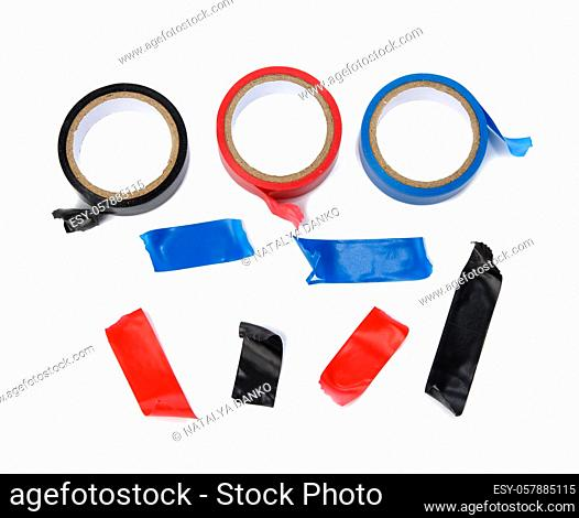 multicolored rubber insulating tape, pieces and roll isolated on white background, top view