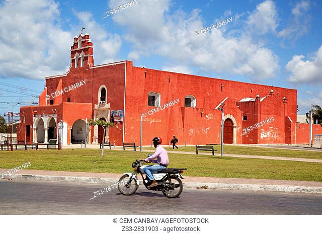 Motorcyclist in front of the Temple of the San Francisco De Asis Extramuros-Templo De San Francisco De Asis Extramuros, Campeche City, Campeche State