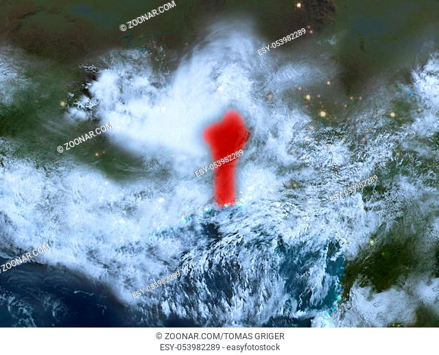 Country of Benin in red on planet Earth with clouds at night. 3D illustration. Elements of this image furnished by NASA