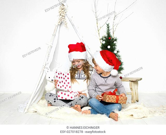 brother and sister with santa hat
