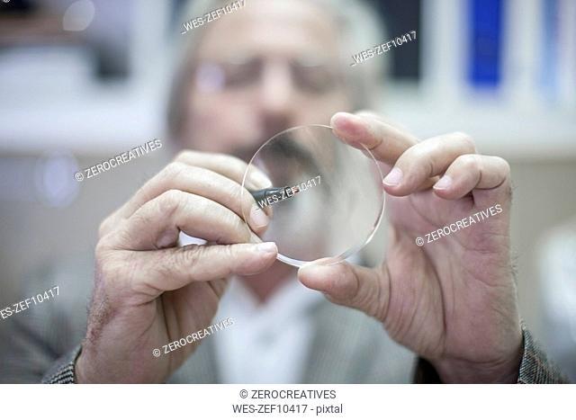 Optometrist looking through eydeglass lens