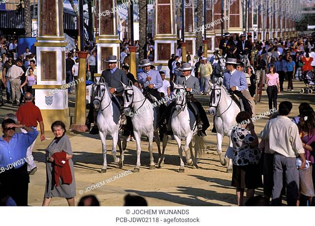 Jerez de la Frontera, caballeros parading on their horses at the Feria del caballo