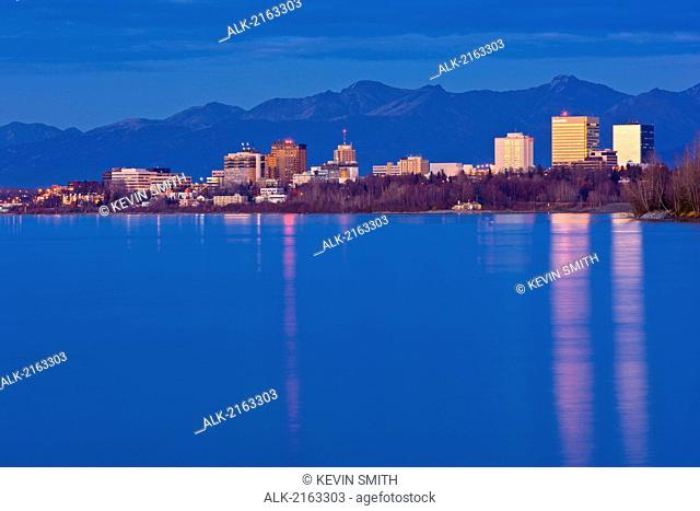 Twilight View Of The Anchorage Skyline Reflecting In The Waters Of Cook Inlet, Southcentral Alaska, Fall