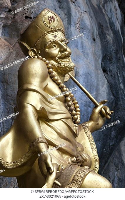 Golden statue of a Chinese god at the Wat Tham Sua Tiger Cave Temple (Wat Tham Seua) in Krabi, Thailand
