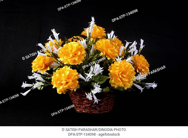 Country basket name of flowers night queen and marigold made in sateen cloth by hand