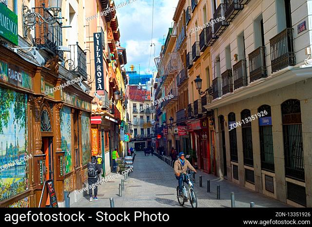 MADRID, SPAIN - NOVEMBER 07, 2016: People at an Old Town street in Madrid. Madrid is the capital of Spain