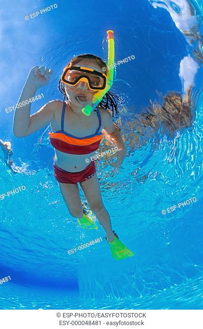 Underwater view of young girl snorkeling. Mayan Riviera, Mexico