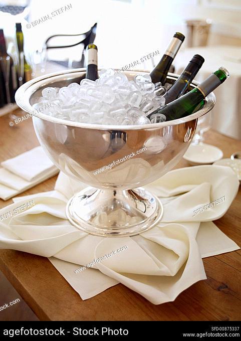 White wine bottles in an ice bucket