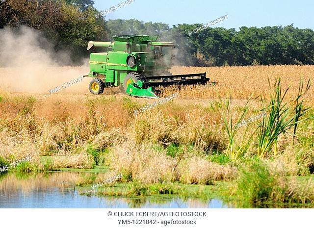 John Deere combine,harvesting crop