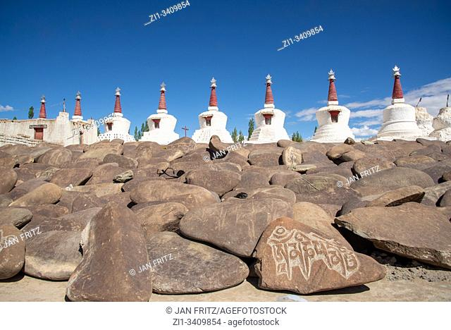 stupas and stones with 'om-mani-padme-hum' at Thiksey monastery in Ladakh, India