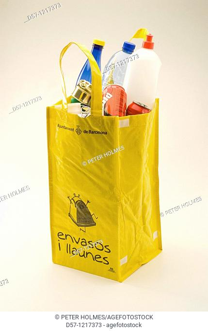 Yellow recycling bag for plastic and aluminum furnished by Ajuntament de Barcelona