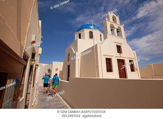 Tourists walking near a church, Oia, Santorini, Cycldes Islands, Greek Islands, Greece, Europe