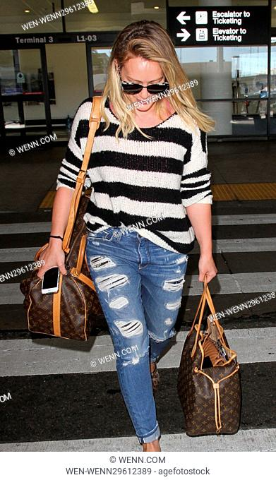 Hilary Duff arrives at the airport carrying Louis Vuitton luggage Featuring: Hilary Duff Where: Los Angeles, California, United States When: 29 Sep 2016 Credit:...