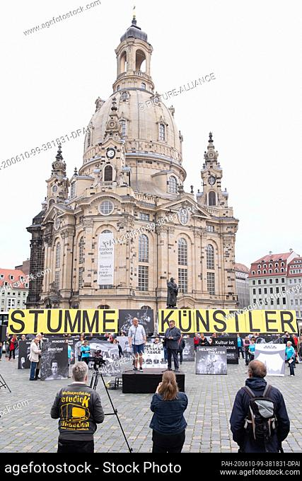 """10 June 2020, Saxony, Dresden: Participants in a demonstration entitled """"""""Silent Artists"""""""" hold oversized letters that form the term """"""""Silent Artists"""""""" on the..."""