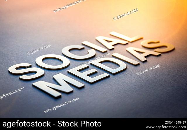 Word social medias written with white solid letters on a board