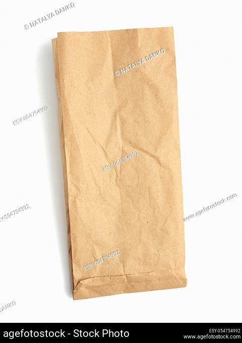 empty paper disposable bag of brown kraft paper isolated on white background, concept of rejection of plastic packaging, template for designer