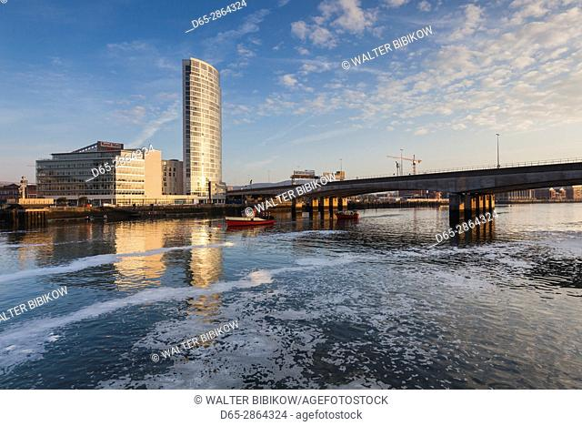 UK, Northern Ireland, Belfast, city skyline along River Lagan, dawn