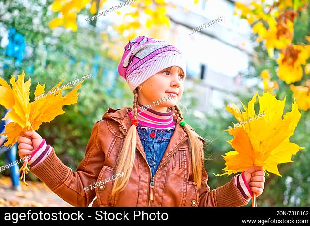 little girl in autumn park, girl and yellow tree