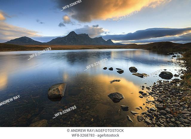 Ben Loyal in the North West Highlands of Scotland, reflected in Loch Hakel at sunset in early November