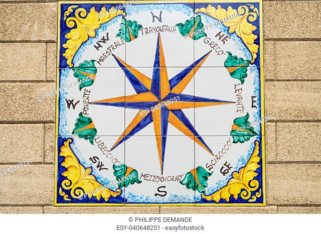 Ceramic compass rose indicating the cardinal points and the direction of the eight winds in the city of Santo di Stefano in northern Sicily
