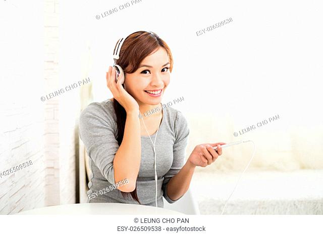 Woman enjoy listenn to song by music player