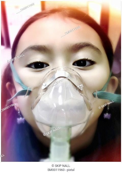 A little girl using a nebulizer