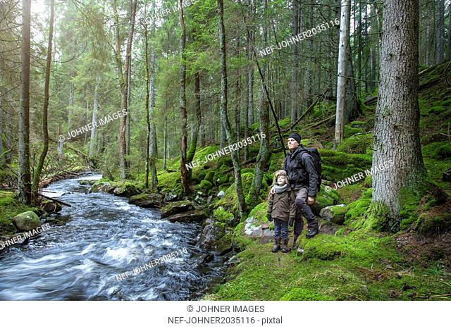 Boy with father in forest