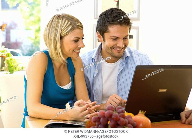 young couple surfing the internet together