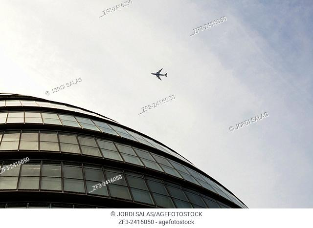 London City hall and a plane on the sky