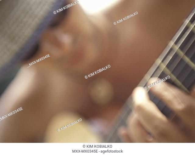 Blurred portrait of man playing Guitar