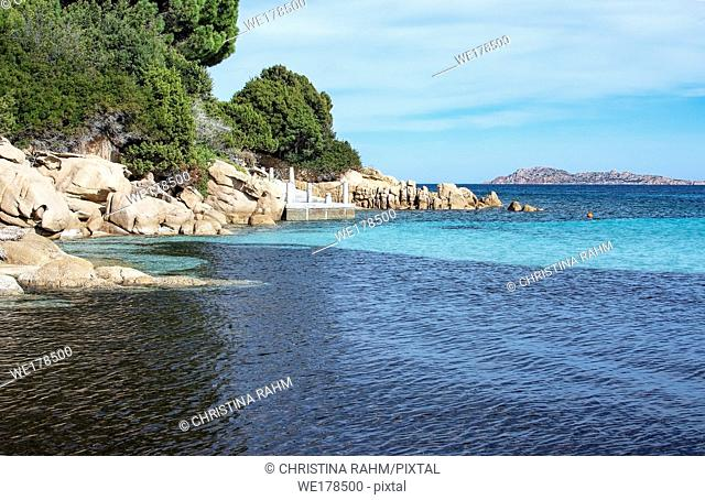 Green water and funny granite rock shapes on a beach in Costa Smeralda, Sardinia, Italy in March
