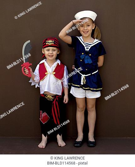 Caucasian children playing dress up