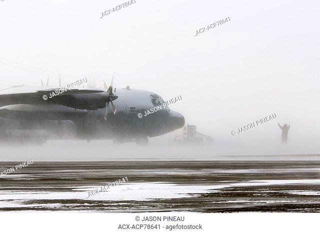 A Royal Canadian Air Force Lockheed Hercules aircraft in a blizzard in Iqaluit, Nunavut, Canada