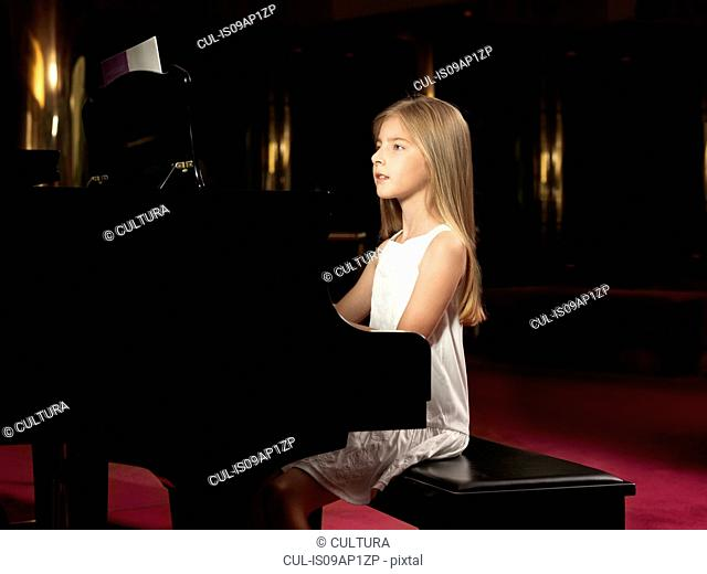 Girl playing piano on stage
