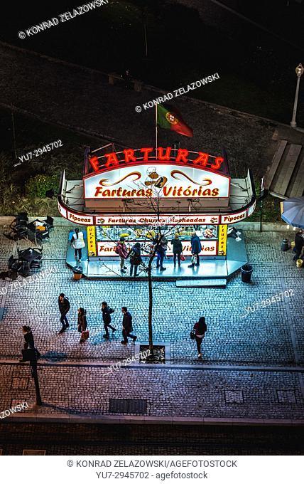 Food booth with Portuguese doughnuts called Farturas in Vila Nova de Gaia city, Portugal