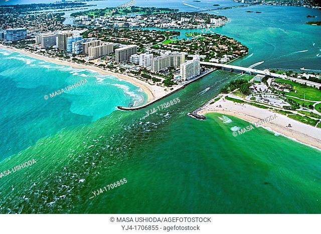 runoff pollution - algae-grown, polluted sea water from cities in Intracoastal Waterway and in Biscayne Bay, running out to Atlantic Ocean through a channel