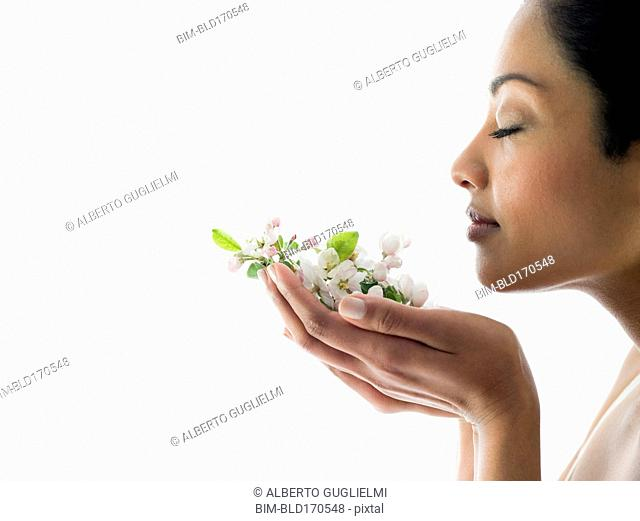 Woman smelling handful of flowers