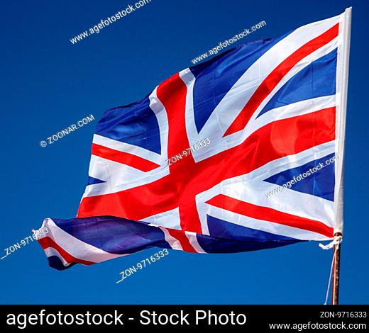 Closeup of Great Britain Flag waving, Flag of the United Kingdom Waving in Wind on Clear Sky. British National Flag. Union Jack