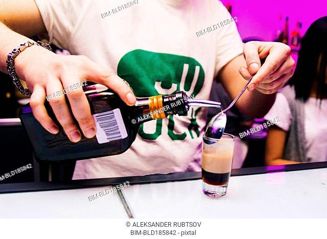 Bartender pouring shot in nightclub