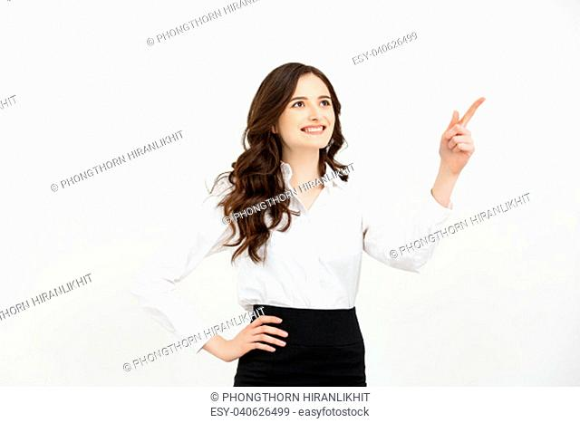 Business Concept Portrait of smiling business woman pointing finger on copy space. iswolated portrait