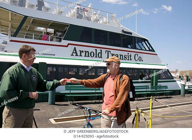 Michigan, Mackinaw City, Arnold Ferry Dock, Straits of Mackinac, Lake Huron, catamaran to Mackinac Island, passengers, boarding, Great Lakes, man, men, bicycle