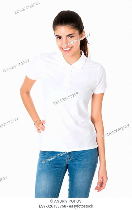 Portrait of beautiful young woman wearing blank tshirt on white background