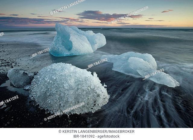 Blocks of ice on the beach at Joekulsárlón, Breiðamerkursandur, South Iceland, Iceland, Europe