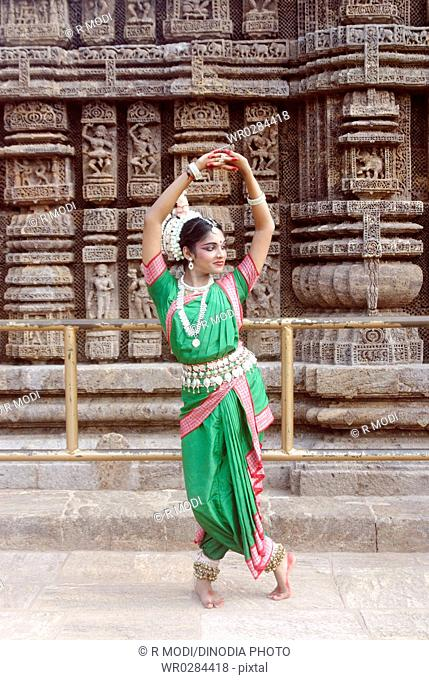 Dancer performing classical traditional odissi dance at Konarak Sun temple , Konarak , Orissa , India MR 736D