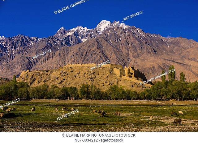 """The Stone Castle, in Tashkurgan, Xinjiang Province, China with the Pamir Mountains behind. Tashkurgan means """"""""the stone castle"""""""" in Uygur"""